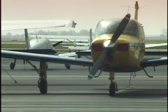 Small Airplanes on Tarmac Stock Footage