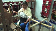 Woman spooling wool yarn Stock Footage