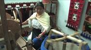 Woman spooling wool yarn Stock Footage