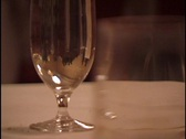 Wine Glass on Table Stock Footage