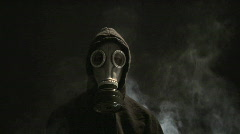 Man in Gas Mask with Rising Smoke Stock Footage