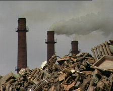 Three factory chimneys and scrap metal Stock Footage