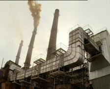 Three factory chimneys Stock Footage