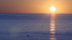 Sunrise Sea of Cortez blue water and sun reflection on water Stock Footage