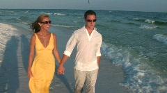 Couple beach walk handheld - stock footage