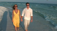 Stock Video Footage of Couple beach walk handheld