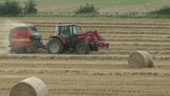 Hay baler working 5 Stock Footage