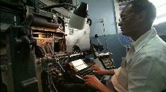 Typesetter at typesetting machine Stock Footage