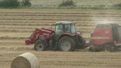 Hay baler working 6 Stock Footage