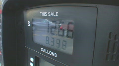 Signs of the times - 1 At the gas pump with rising fuel prices - stock footage