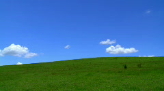 Green Field Hill with Fluffy White Clouds Time Lapse Stock Footage