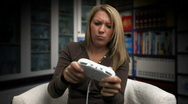 Stock Video Footage of Girl Plays Video Game 136 - Wins