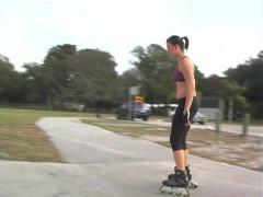 Lovely Young Brunette Rollerblading-1a Stock Footage