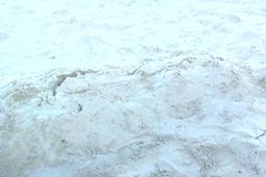 Beautiful Bikini-clad Brunette Sand Surprise Stock Footage
