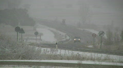 Winter road during snow storm - stock footage