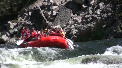 Whitewater Rafting down rapid - stock footage