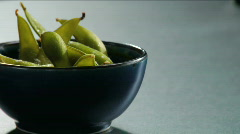 Salt sprinkle on edamame Stock Footage