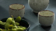 Stock Video Footage of Man pours sake next to edamame