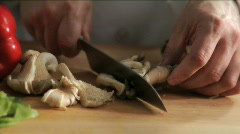 Chef chops oyster mushrooms Stock Footage
