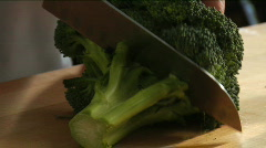Chef cuts broccoli - stock footage