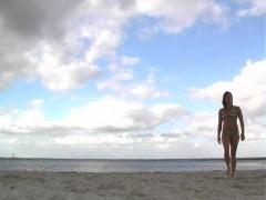 Lovely Brunette on a Freshwater Beach (3) Stock Footage
