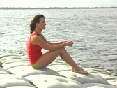 Lovely Brunette on a Lakeshore (1) Stock Footage