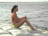 Lovely Brunette on a Lakeshore (4) Stock Footage