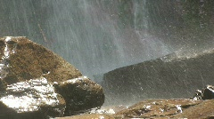 Waterfall Rain Spraying Down on Rocks Stock Footage