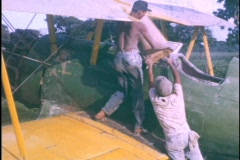 Spanish Workers Load Chemicals into a Hopper Crop Duster Dusting Plane DDT Stock Footage