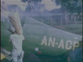 Stock Video Footage of Spanish Workers Load Chemicals into a Hopper Crop Duster Dusting Plane DDT