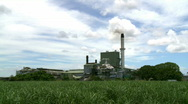 Stock Video Footage of Sugar Mill with Sugar Cane Growing in Foreground