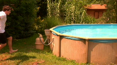 Slow Motion Man Jumping in Pool Stock Footage