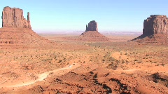 Monument Valley Tribal Park with Car on Road – Time Lapse Stock Footage