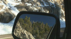 Looking into the rear view mirror - mountain scenics Stock Footage