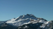 Snowy alpine mountain pan Stock Footage