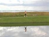 Lovely Brunette Walking Along a Lakefront Stock Footage