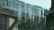 Icicles on chalet Stock Footage