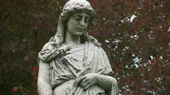 Grieving cemetery statue. Medium shot. Stock Footage