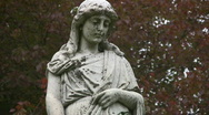 Stock Video Footage of Grieving cemetery statue. Medium shot.