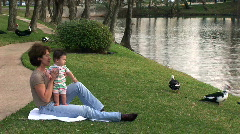 Grandmom and baby at the river Stock Footage