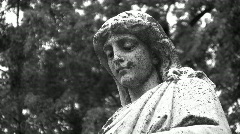 Grieving cemetery statue. Black and white.  Stock Footage
