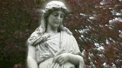 Grieving cemetery statue with heavenly rays. Stock Footage