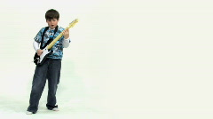 Boy Plays Guitar Video Game - Left Justified - stock footage