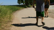 Teens Down Path Near Beach Stock Footage