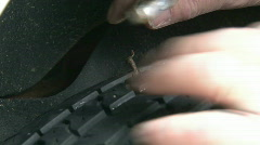 Pulling Nail from Car Tire Stock Footage