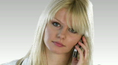 Atractive Blonde Woman on the phone Stock Footage