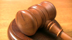 Gavel striking a sounding block. - stock footage