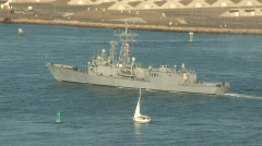 Battleship and sailboat Stock Footage