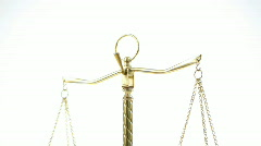 Vertical pan of scales of justice - stock footage