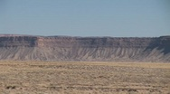 Stock Video Footage of Pan of Distant Desert Buttes